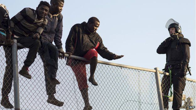 Migrants trying to enter Melilla