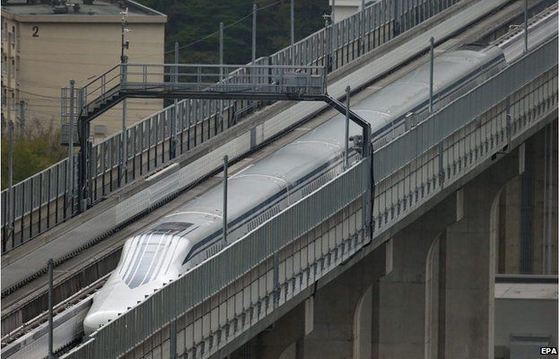 A handout picture provided by the Central Japan Railway Co shows a maglev train speeding on an experimental track in Yamanashi Prefecture, central Japan, 21 April 2015