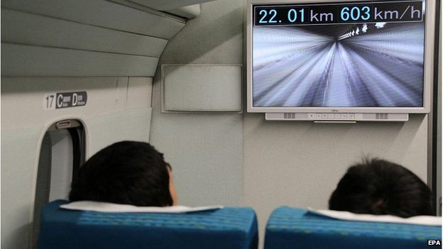 A handout picture provided by the Central Japan Railway Co shows a screen displaying the current speed of a maglev train in Yamanashi Prefecture, central Japan, 21 April 2015