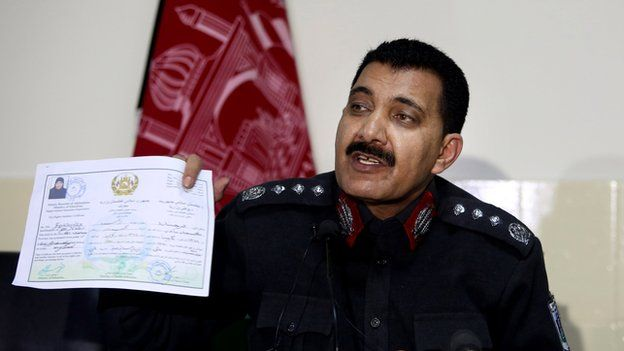 Kabul police chief Abdul Rahman Rahimi shows an education certificate of Farkhunda at a press conference following the arrest of suspects