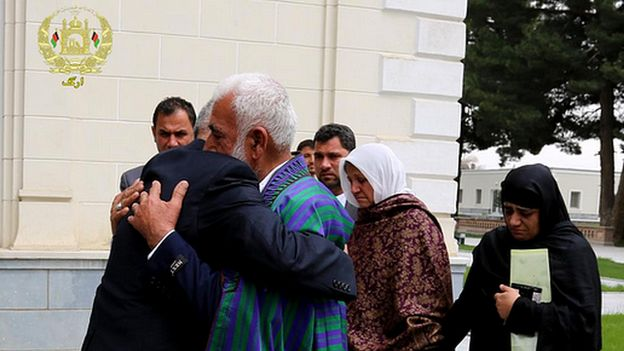 President Ghani hugs Farkhunda's father as the family visits the Presidential palace