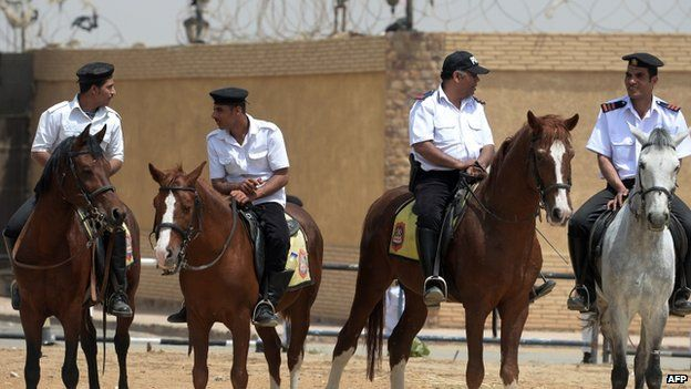 "Egyptian mounted security stand guard outside the police academy during the trial of Egypt""s former Islamist president Mohamed Morsi, in the capital, Cairo, on April 21, 2015"
