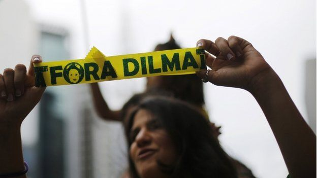 """Demonstrator holds a ribbon that reads """"Out Dilma"""" during a protest against Brazil's President Dilma Rousseff in Sao Paulo"""