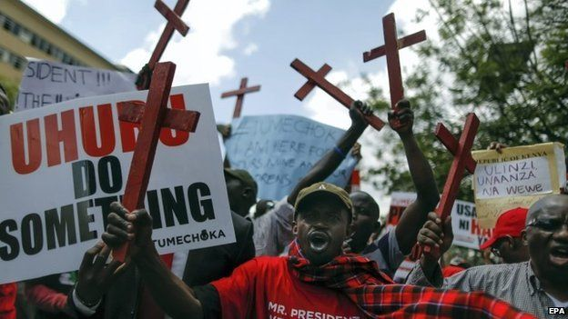 Demonstrators hold up painted crosses symbolizing 28 people who were killed in a recent attack on a bus in Mandera by Somalia's Islamist militant group al-Shabab, in protest against government and its failure to protect people in Nairobi, Kenya, 25 November 2014