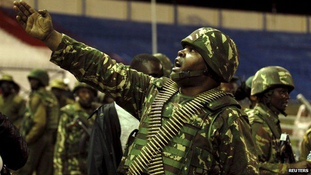 A policeman controls issued orders to his juniors when people rescued from the Garissa University attack meet their relatives at Nyayo stadium in Kenya's capital Nairobi 4 April 2015
