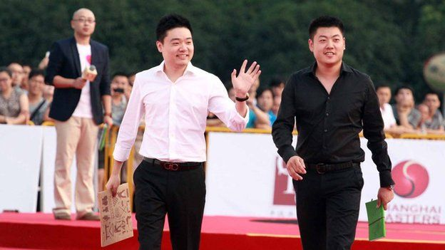 Ding Junhui (left) and Liang Wenbo on the red carpet before the Shanghai Masters