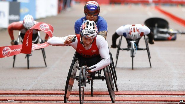 "USA""s Joshua George wins the Men""s wheelchair race ahead of Great Britain""s David Weir"