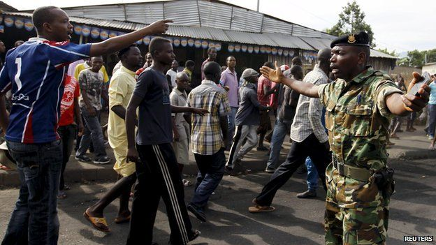 A military officer tries to control protesters in Bujumbura, April 27, 2015