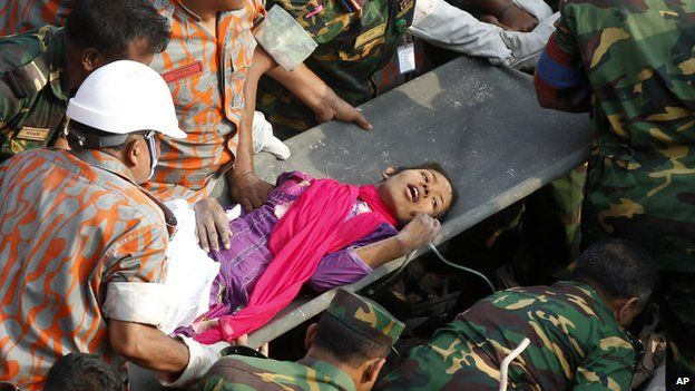 Survivor of a building collapse Reshma Begum lies on a stretcher after being pulled out from the rubble of a building on 10 May, 2013