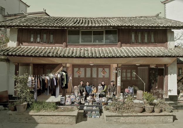 Aer Yingming and her family outside their home