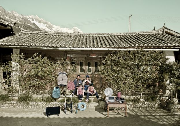 Lu Qunzhi with his family and possessions