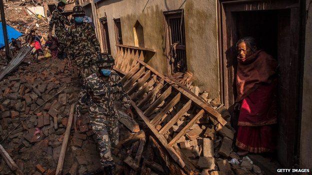 Nepalese Rangers soldiers walk among debris of houses on 29 April 2015 in Bhaktapur, Nepal.