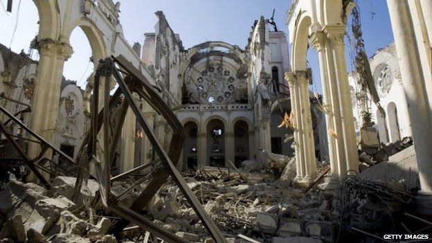 Handout image provided by the United Nations on 16 January 2010, the remains of a cathedral are seen in Port-au-Prince, Haiti.