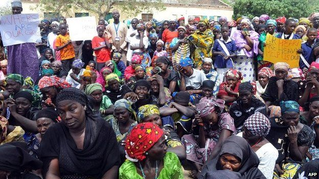 Parents of missing Chibok schoolgirls gather on April 14, 2015 to mark the one-year anniversary of the abduction of 219 schoolgirls by Boko Haram Islamists in the northeastern Nigerian city of Chibok in Borno State.