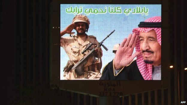 """A billboard in Riyadh, showing a soldier and Saudi King Salman, reads: """"My country, we are all protecting your soil."""" (15 April 2015)"""
