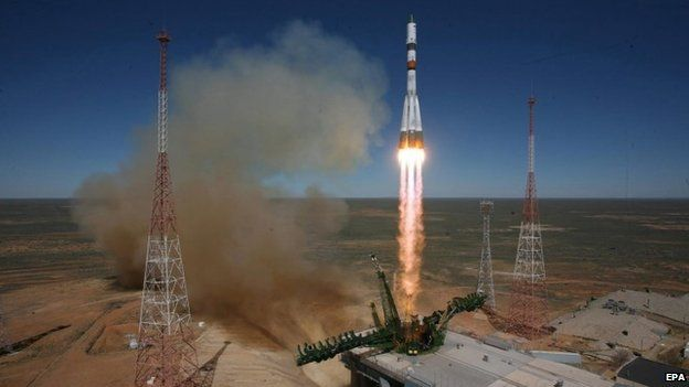 Picture released by the press service of the Russian Federal Space Agency Roscosmos shows a Russian Soyuz-2.1a launch vehicle carrying Progress M-27M cargo ship lifting off from the Baikonur cosmodrome in Kazakhstan, 28 April 2015.