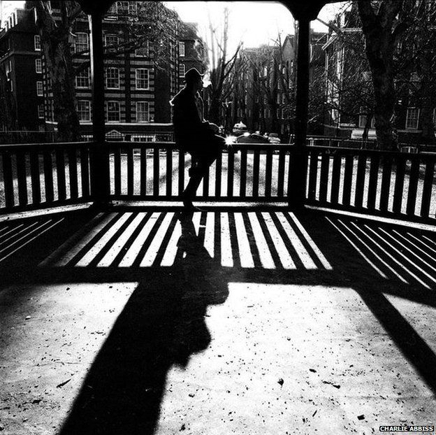 Black and white photo of man on bandstand