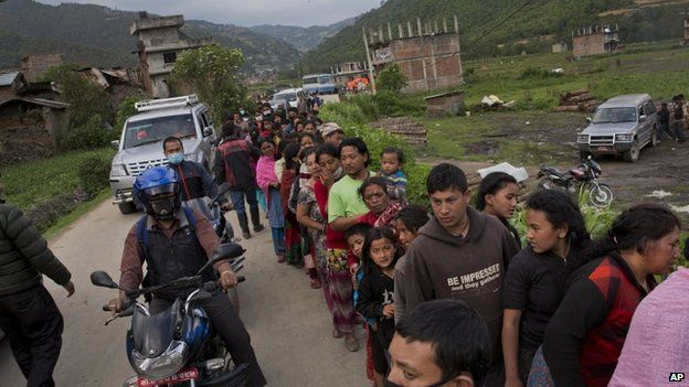 Queue to receive food being distributed in Sakhu, on the outskirts of Kathmandu. 29 Apr 2015