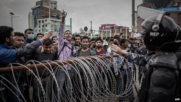 Riot police face angry crowd in Kathmandu. 29 Apr 2015