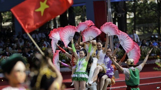 Performers show their skills during a parade celebrating the 40th anniversary of the end of the Vietnam War which is also remembered as the fall of Saigon, in Ho Chi Minh City, Vietnam, Thursday, April 30, 2015.