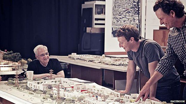 Facebook founder Mark Zuckerberg looks at a model of the new building with architect Frank Gehry