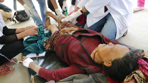 Nepali woman injured in a remote area of the Gorkha district screams in pain as she is treated by Nepali doctors in Ghorka on 30 April, 2015