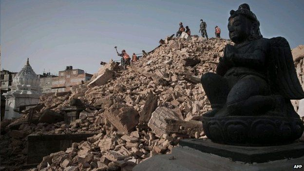 Nepalese Armed Police Force clear rubble at the Narayan temple in Kathmandu