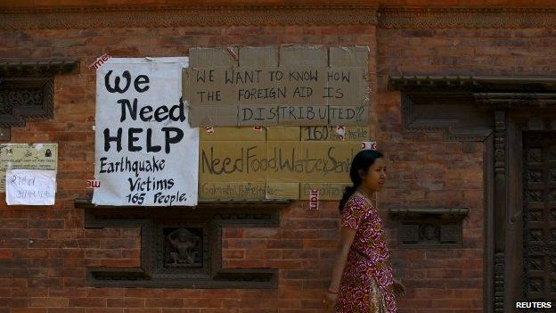 Earthquake victims put up a notice for help on the walls of a temple after last week's earthquake in Bhaktapur, Nepal May 2, 2015.