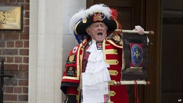 Tony Appleton, a town crier, announces the birth of the royal baby outside the Lindo Wing