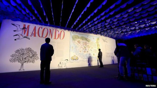 Visitors look at an exhibit at the entrance of the Macondo pavilion during Bogota's 28th International Book Fair on 22 April, 2015.