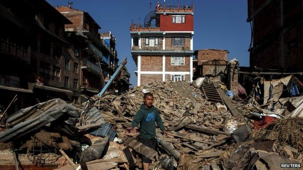 A local resident clears the rubble from his home which was destroyed after last week's earthquake in Bhaktapur, Nepal, May 4, 2015.