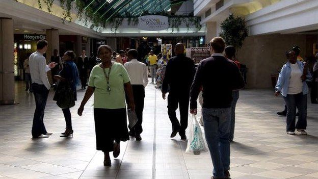 People walk trough the main alleys of the Sandton City shopping centre on 18 May 2010 in Johannesburg, South Africa.