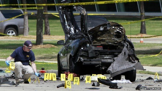 FBI agent examines car used by gunmen outside the centre in Garland. 4 May 2015