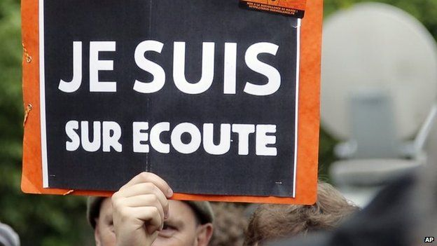 """A demonstrator holds a placard that reads: """"I am on Record"""", during a protest in Paris (04 May 2015)"""