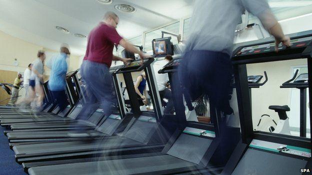 Men running at treadmills