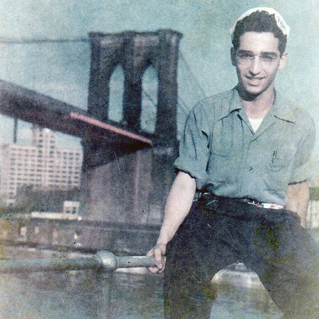 Gunter (Gary) Wolff photographed against a backdrop of the Brooklyn Bridge after he arrived in New York