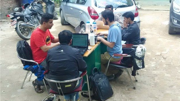 Kathmandu Living Labs team working in a parking lots because aftershocks continued after the quake