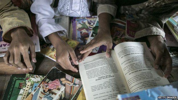 Children read book at Miftahul Huda Islamic elementary school on May 5, 2015 in Serang Village, Purbalingga, Central Java Indonesia.