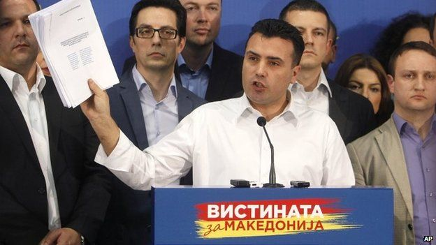 Zoran Zaev, the leader of the opposition Social-Democratic Alliance of Macedonia, shows lists of wire-tapped journalists during a news conference in the party headquarters in Skopje, Macedonia on 25 February 2015