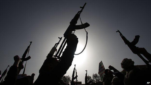 Houthi rebels brandish weapons