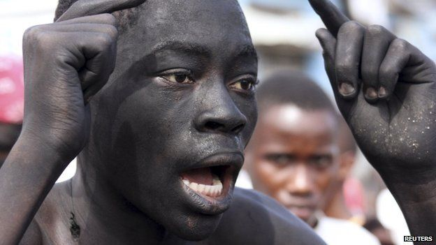 A protester with his face marked with black soot, participates in demonstrations in Burundi's capital Bujumbura, 6 May 2015