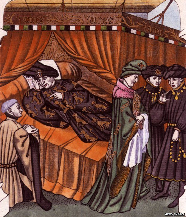 Circa 1400, Charles VI, King of France, is attended in his bedchamber by servants and ministers