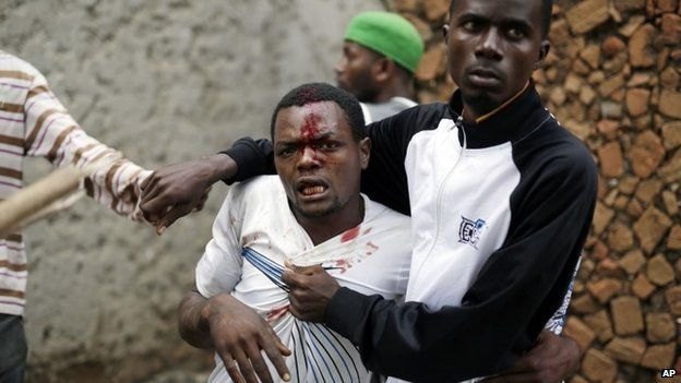 Jean Claude Niyonzima, a suspected member of the ruling party's Imbonerakure youth militia, is restrained as a mob gathers around his house, as protests continue against President Pierre Nkurunziza's decision to seek a third term in office in the Cibitoke district of Bujumbura, Burundi, 7 May 2015