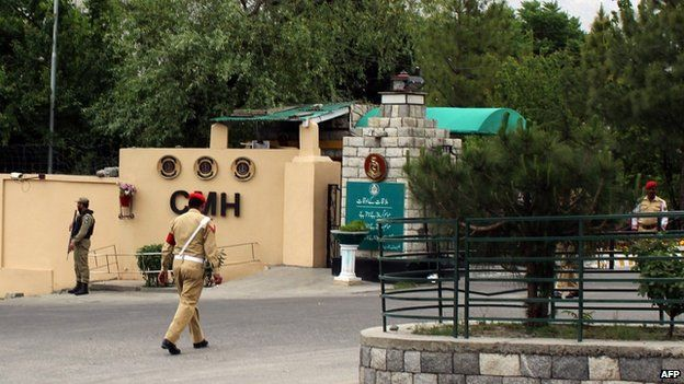 Pakistani soldiers stand guard outside a military hospital where victims of a helicopter crash were brought for treatment in Gilgit on 8 May 2015.