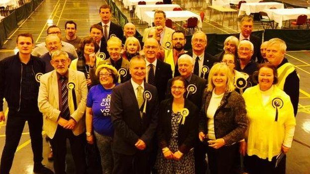 Pete Wishart poses with his SNP team at the count