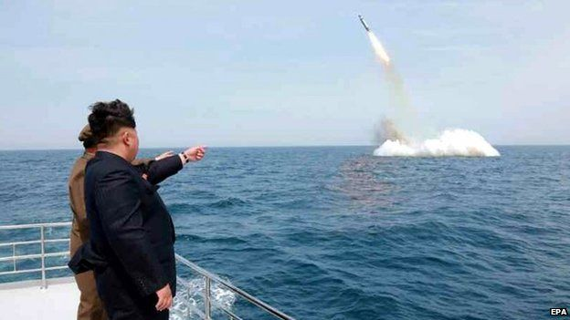North Korean leader Kim Jong-un at the apparent launch of a missile from a submarine