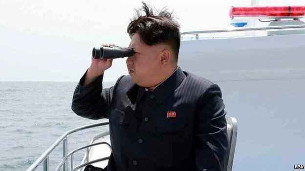 An image obtained by Yonhap News Agency showing North Korean leader Kim Jong-un looking through a pair of binoculars at a ballistic missile (not in frame),