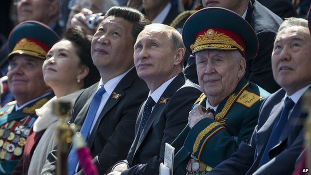 Russian President Vladimir Putin, centre, Chinese President Xi Jinping, third left, watching Victory Parade, with Xi's wife Peng Liyuan, second left, Kazakh President Nursultan Nazarbayev on the right