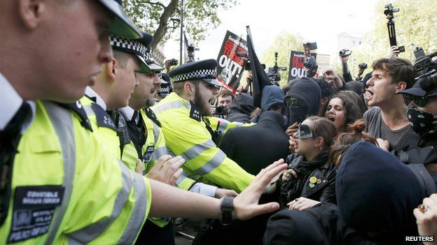 Protesters and police clash