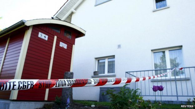 A police ribbon is seen in front of a house in Wuerenlingen, Switzerland 10 May 2015.
